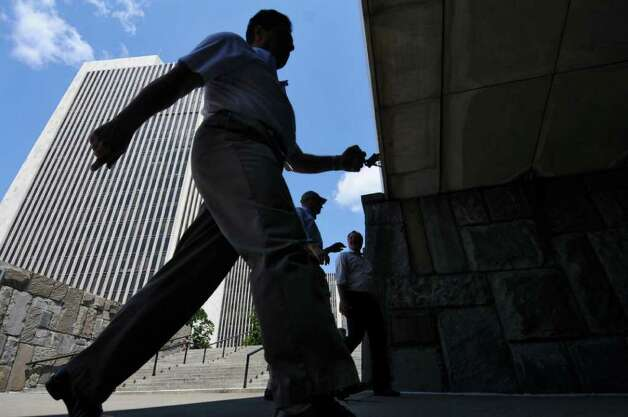 Pedestrians walk on Madison Avenue below the Empire State Plaza on Tuesday Aug. 2, 2011 in Albany, NY.  (Philip Kamrass / Times Union) Photo: Philip Kamrass / 00014126A