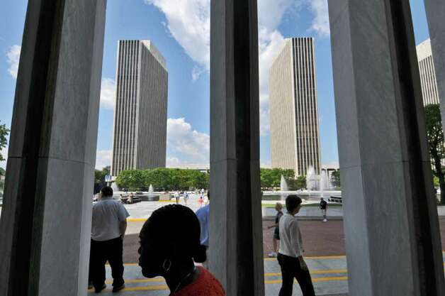 Pedestrians walk on the Empire State Plaza on Tuesday Aug. 2, 2011 in Albany, NY.  (Philip Kamrass / Times Union) Photo: Philip Kamrass / 00014126A