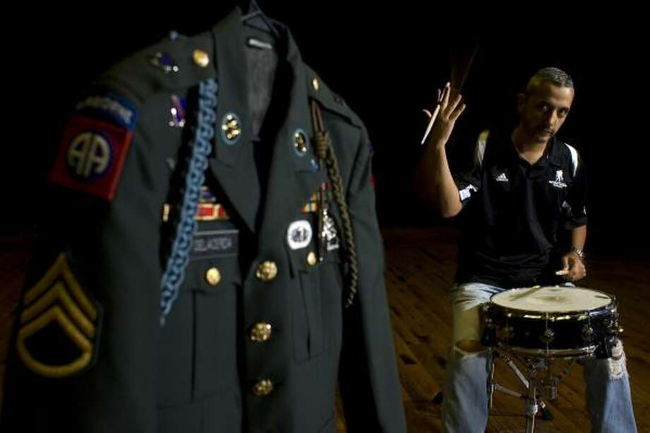 Retired Staff Sgt. Paul DeLaCerda, 38, wounded in Iraq, plans auditions for his band this month. Photo: Johnny Hanson, Chronicle