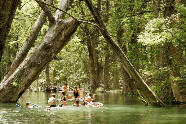 """""""How to Eat Fried Worms"""" film crew members swim in Wimberley's famed Blue Hole during a break from filming in 2005."""