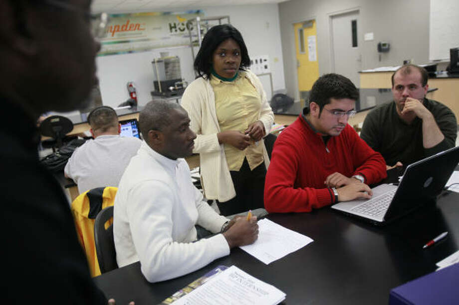 Students, from left, Cheikh Barry, 39, Asenat Onguene, 27, Jose Miguel Fragacha, 29, and Daniel Cranmer, 30, collaborate in their green technology class at Houston Community College. Photo: Mayra Beltran, Chronicle