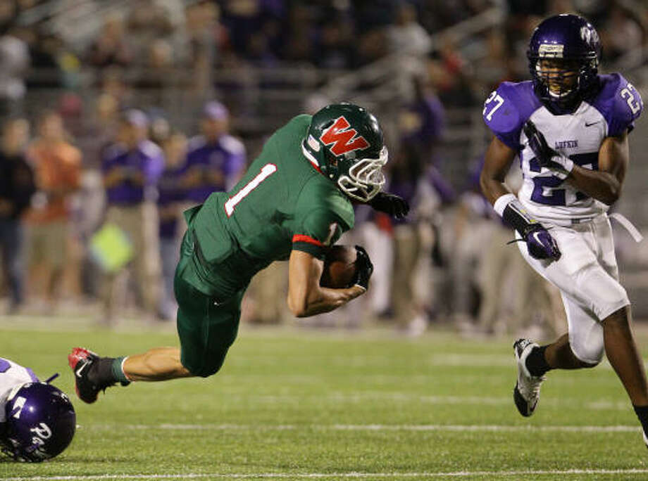 The Woodlands running back Daniel Lasco helped put the game away with a pair 30-yard runs in the fourth quarter. Photo: Nick De La Torre, Houston Chronicle