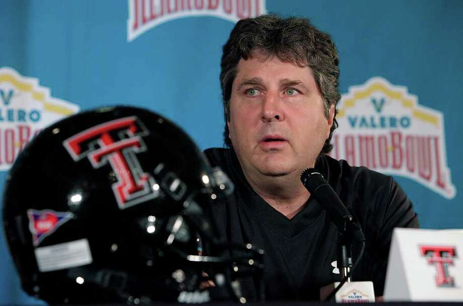 2009: Texas Tech coach Mike Leach answers questions at a press conference for the 2010 Valero Alamo Bowl at the Club at Sonterra on Thursday, Dec. 10, 2009. Leach, who was fired a few weeks later, missed the Red Raiders' 41-31 victory over Michigan State at the bowl game. Photo: Kin Man Hui/kmhui@express-news.net / San Antonio Express-News