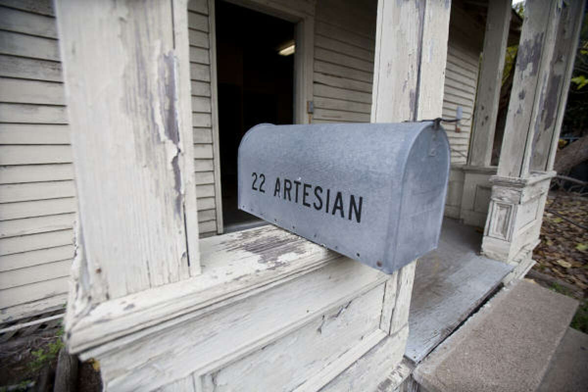 A mailbox with the Eisele cottage's original address is attached to the cottage's original porch. The neighborhood it was once apart of is now the Houston Police Department's parking lot.