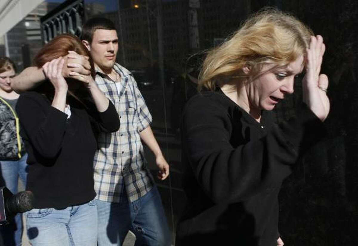 Donna Stone, right, David Brian Stone's ex-wife, exits the federal courthouse in Detroit last week. David Stone and David Stone Jr., Donna's son, were among the charged Christian militia members.