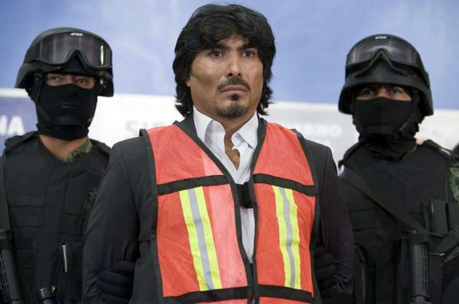 """Drug boss Gerardo Alvarez-Vazquez, aka """"El Indio"""", from the Beltran Leyva cartel, is put on public display by members of the Mexican Army on Thursday. Alvarez-Vazquez was arrested with 17 others after a shootout Wednesday night at his home outside Mexico City. Photo: ALFREDO ESTRELLA, AFP/Getty Images"""