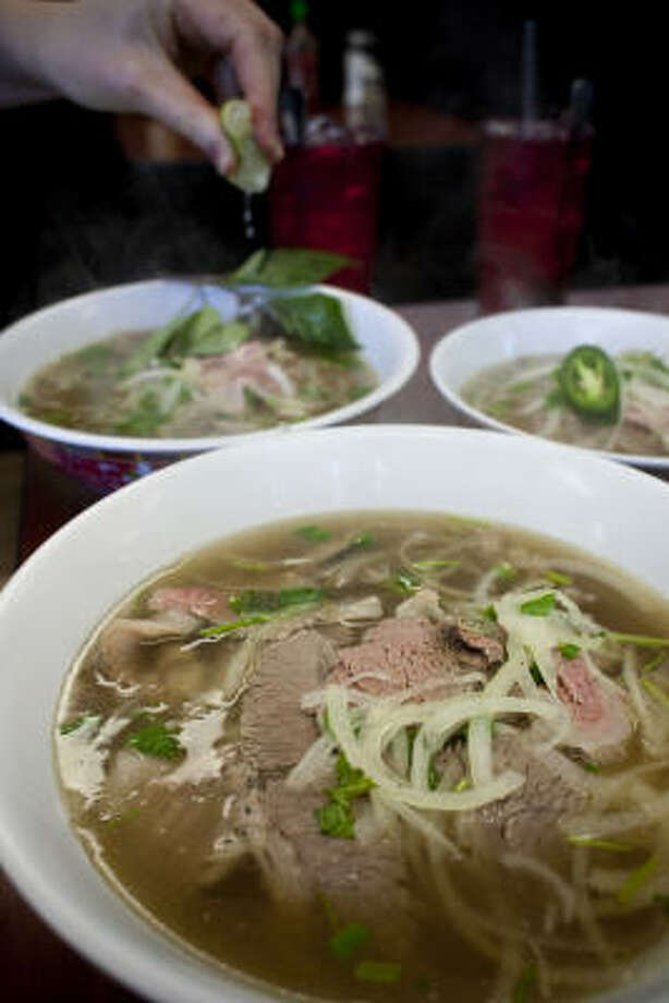 Pho Binh Trailer's modest appearance belies its flavorful pho, some of the best in Houston. Photo: Eric Kayne :, For The Chronicle