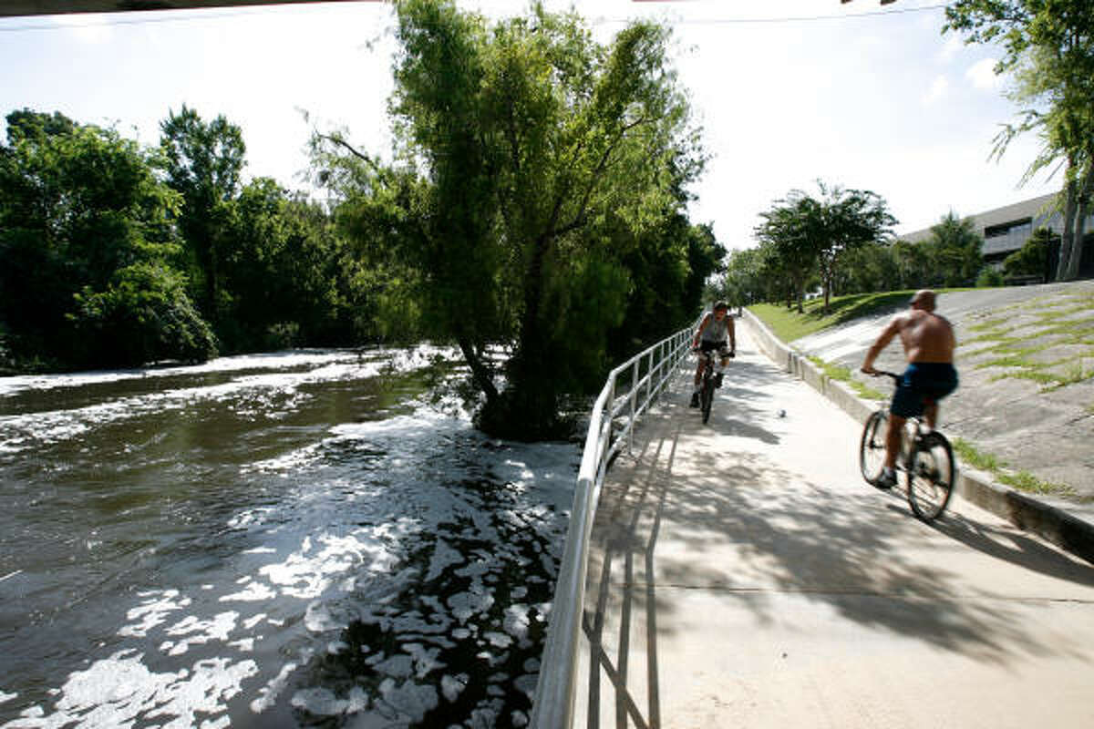 """""""The greatest thing is that the bayous are already there,"""" says developer Ed Wulfe of a proposal to develop land along bayous using existing trails, like this one off Buffalo Bayou at Terry Hershey Park."""