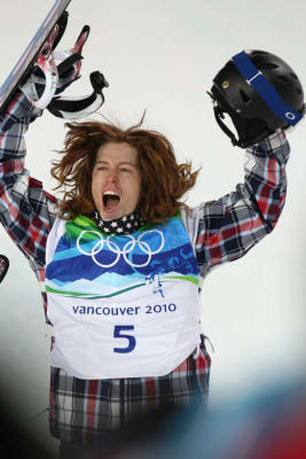 Shaun White of the United States celebrates his gold-medal winning performance in the men's snowboard halfpipe. Photo: Mike Siegel, MCT