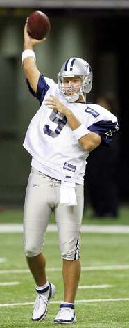 Quarterback Tony Romo passes during the afternoon session of Dallas Cowboys training camp Sunday, July 31, 2011 at the Alamodome. Photo: Edward A. Ornelas/eaornelas@express-news.net / © SAN ANTONIO EXPRESS-NEWS (NFS)
