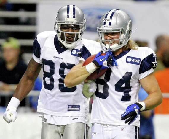 Wide receivers Dez Bryant (left) and Tysson Poots run drills during the afternoon session of Dallas Cowboys training camp Sunday, July 31, 2011 at the Alamodome. Photo: Edward A. Ornelas/eaornelas@express-news.net / © SAN ANTONIO EXPRESS-NEWS (NFS)