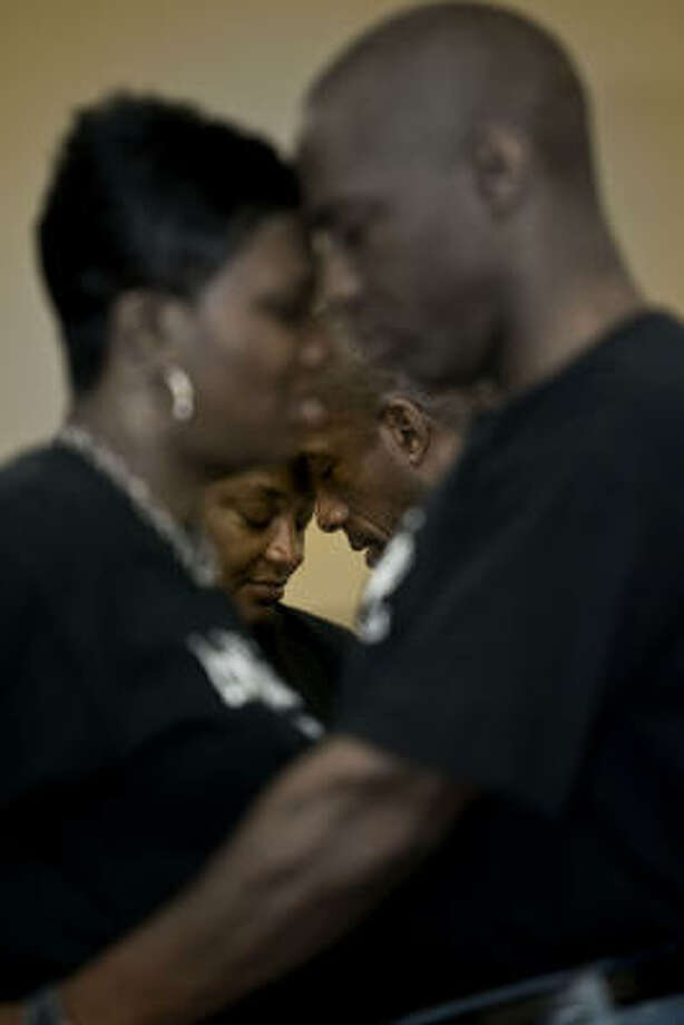 Renae and Keith Brown, in foreground, and Kym and Cecil Snow show their love. Photo: James Nielsen, Chronicle