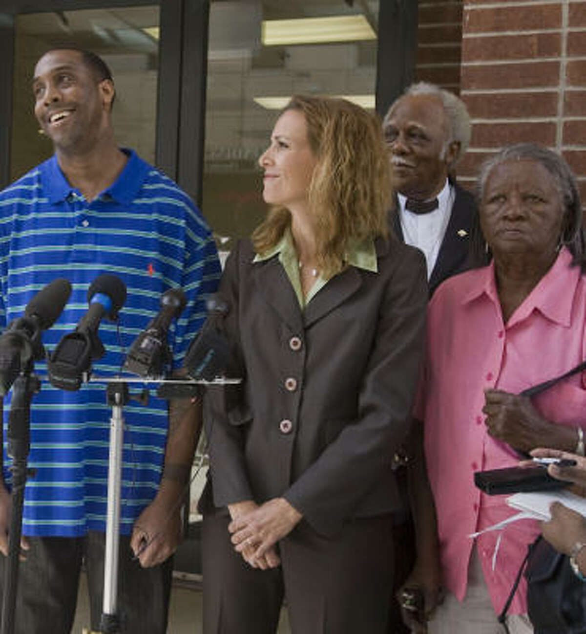 Allen Wayne Porter, 39, who spent nearly two decades in prison for a crime he didn't commit, is all smiles Friday as he is surrounded by family members and his lawyer, Casey Garrett.