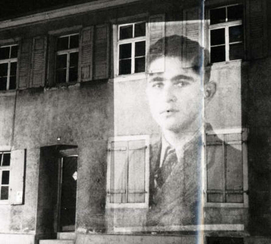 A photo of Sandy Lessig's father, Walter Breisach, is projected onto the outside of a building during a program about Jews who were forced to leave Germany or who perished in concentration camps during World War II. Her father was 16 in early 1938 when his family fled to the United States. Photo: Photo Courtesy Of Sandy Lessig