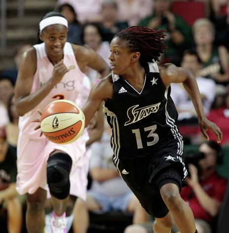 Seattle Storm's Swin Cash, left, trails San Antonio Silver Stars' Danielle Robinson on a drive in the second half of a WNBA basketball game Tuesday, Aug. 2, 2011, in Seattle. The Storm won 78-64. Photo: Elaine Thompson/Associated Press