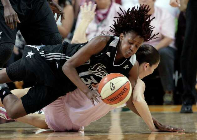 San Antonio Silver Stars' Danielle Robinson (13) gets tangled with Seattle Storm's Sue Bird as they both dive for a loose ball in the first half of a WNBA basketball game Tuesday, Aug. 2, 2011, in Seattle. Photo: Elaine Thompson/Associated Press