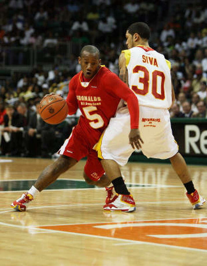 Mason-Griffin, left, was a McDonald's All-American, Jordan Brand All-American and the 2009 Gatorade Texas High School Player of the Year at Madison. Photo: Doug Benc, Getty Images