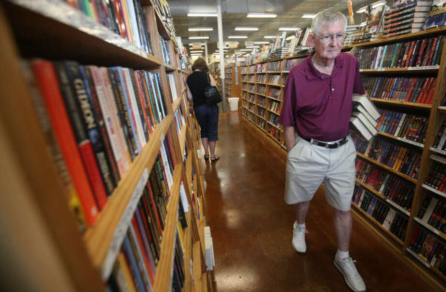 Bill Dubois heads to the checkout registers this week at the Half Price Books at 11960 Westheimer. The Dallas-based Half Price Books chain has seen its sales rise since the recession as consumers try to save money. Photo: Mayra Beltran :, Chronicle