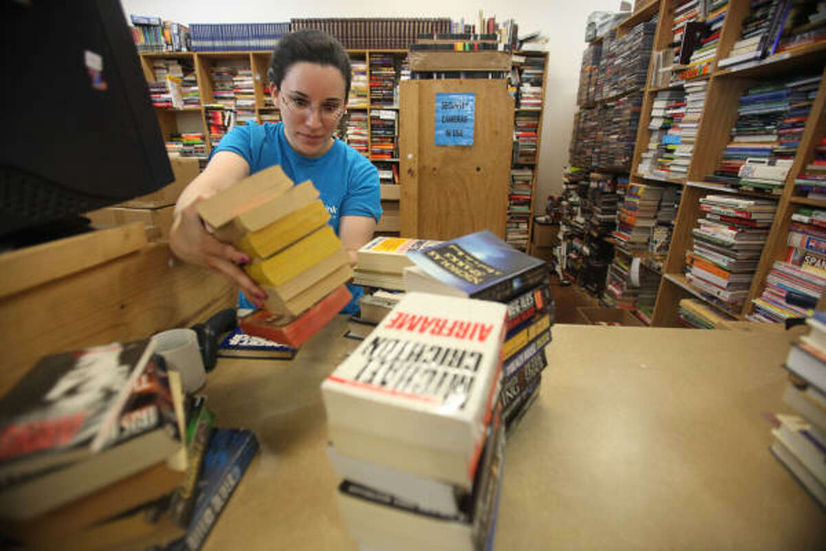 Half Price Books will buy back your books. Not for much, though, but at least you'll get the chance to de-clutter your home and make a few bucks while you're at it. Click here to find the location nearest you.