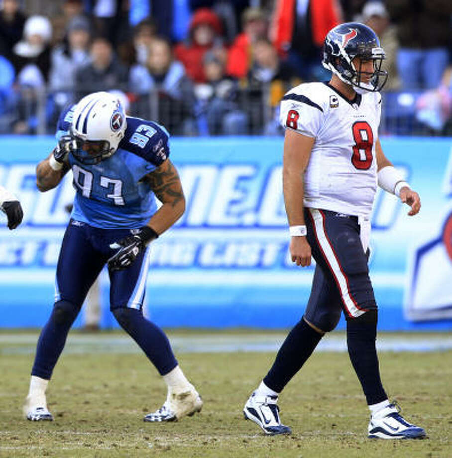 Titans defensive end Jason Babin (93), a former Texan, celebrates after forcing a fumble by a glum Texans quarterback Matt Schaub in the fourth quarter Sunday. Schaub passed for 325 yards and a pair of touchdowns in the loss. Photo: Brett Coomer, Chronicle