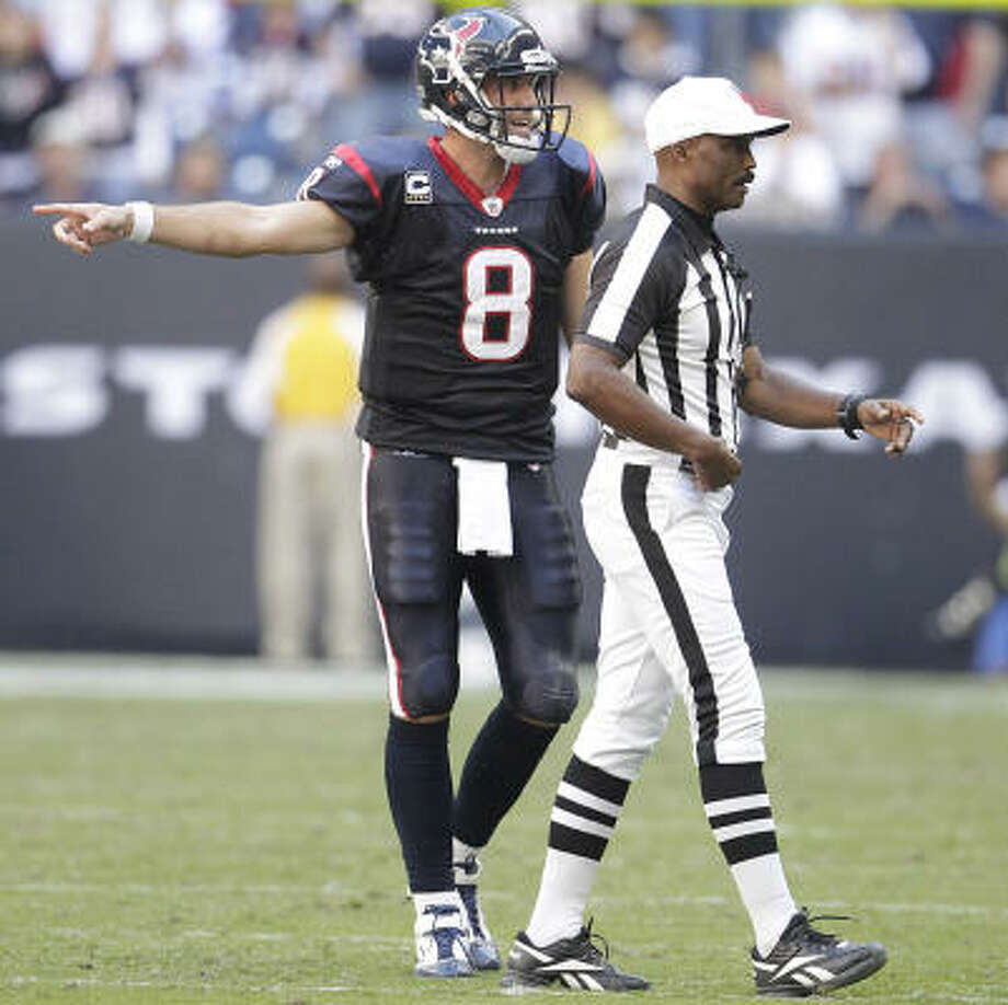 Texans quarterback Matt Schaub argues with referee Mike Carey after Carey penalized Schaub for intentional grounding late in the fourth quarter Sunday. Photo: Karen Warren, Chronicle