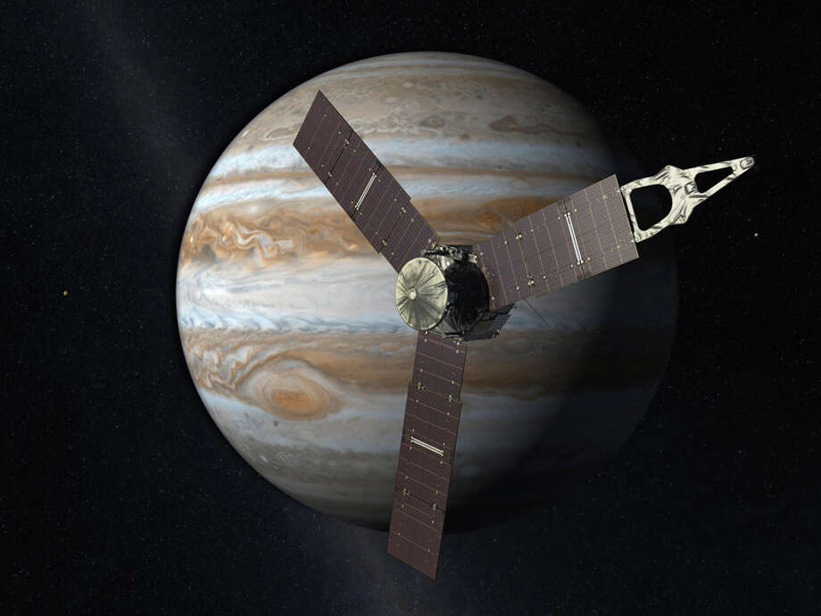 This 2010 artist's rendering depicts NASA's Juno spacecraft with Jupiter in the background. The robotic explorer Juno is set to become the most distant probe ever powered by the sun. Launch is set for Aug. 5, 2011, aboard an unmanned Atlas V rocket, barely two weeks after NASA's final space shuttle flight. Photo: NASA / AP / NASA/JPL