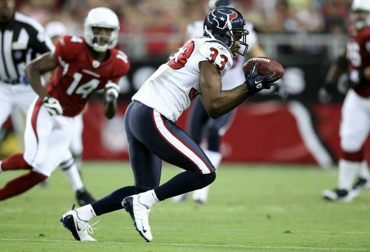Safety Troy Nolan intercepts a pass during the first preseason game against the Cardinals at Arizona.