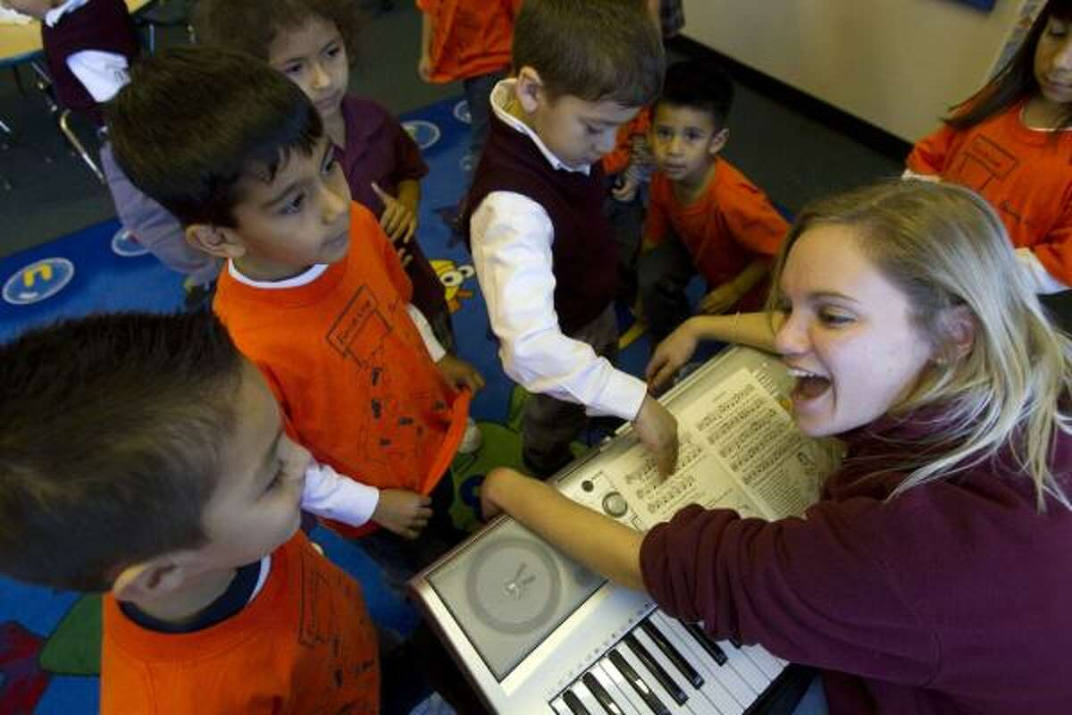 Music teacher Maggie McGrath leads a music class Friday at Our Lady of Guadalupe, which is one of 13 inner-city Catholic schools the Archdiocese is helping.