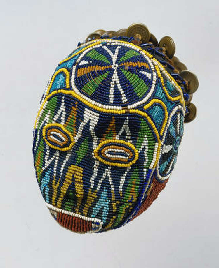 Trophy Head (Atwonzen). Bamileke tribe from Cameroon (19th-20th century). Made of wood, cloth, glass beads and brass buttons. Photo: The Menil Collection