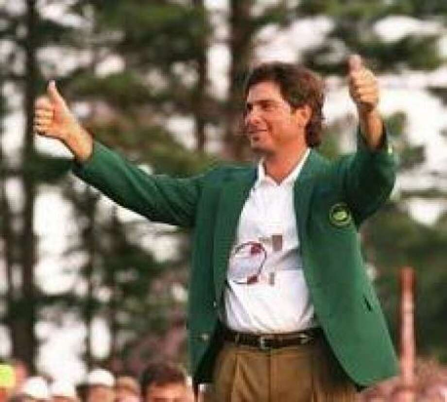 Jim Nantz's favorite moment as a sportscaster happened when Fred Couples, his suitemate at the University of Houston, won the Masters in 1992. Nantz was on hand for the green jacket presentation at Butler Cabin. Photo: Lenny Ignelzi, Associated Press