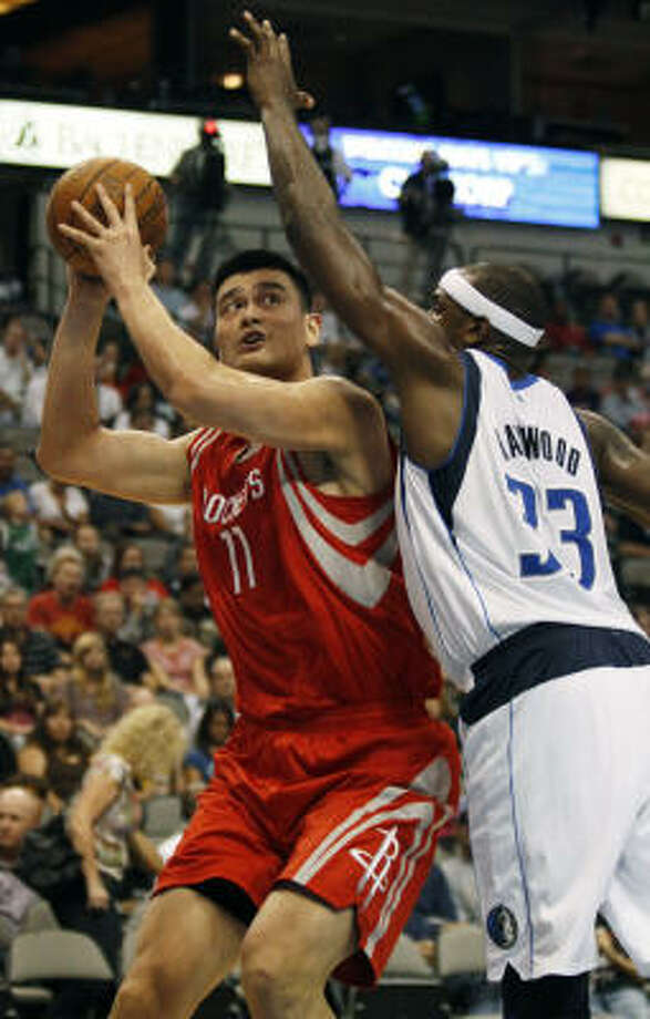 Rockets center Yao Ming (11) looks to shoot over the Mavericks' Brendan Haywood in the first half Friday night. Photo: Mike Fuentes, AP