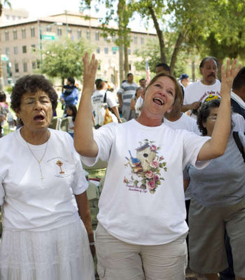 Maria Uribe, center, and other opponents of Bill 1070 rejoice as they hear the news of the ruling. Photo: Nick De La Torre, Chronicle