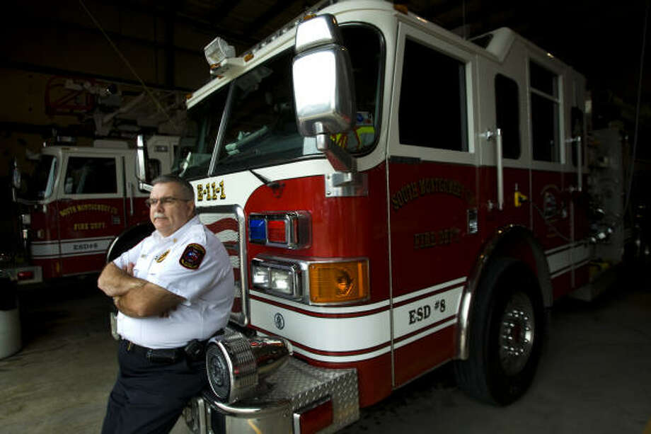 Chief Robert Hudson, of the South Montgomery County Fire Department, says service and funding levels are related. His department relies on salaried firefighters. Photo: Brett Coomer, Chronicle
