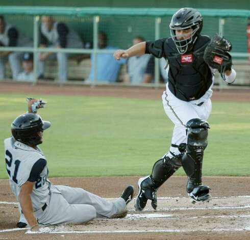 The Corpus Christi Hooks' Jonathan Villar (left) slides safe into home under Missions catcher Ali Solis during a game on Tuesday, Aug. 2, 2011, at Wolff Stadium. Photo: Darren Abate/Special To The Express-News