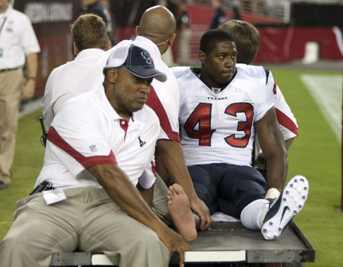 Texans running back Ben Tate was carted off the field in the third quarter of Saturday's game.