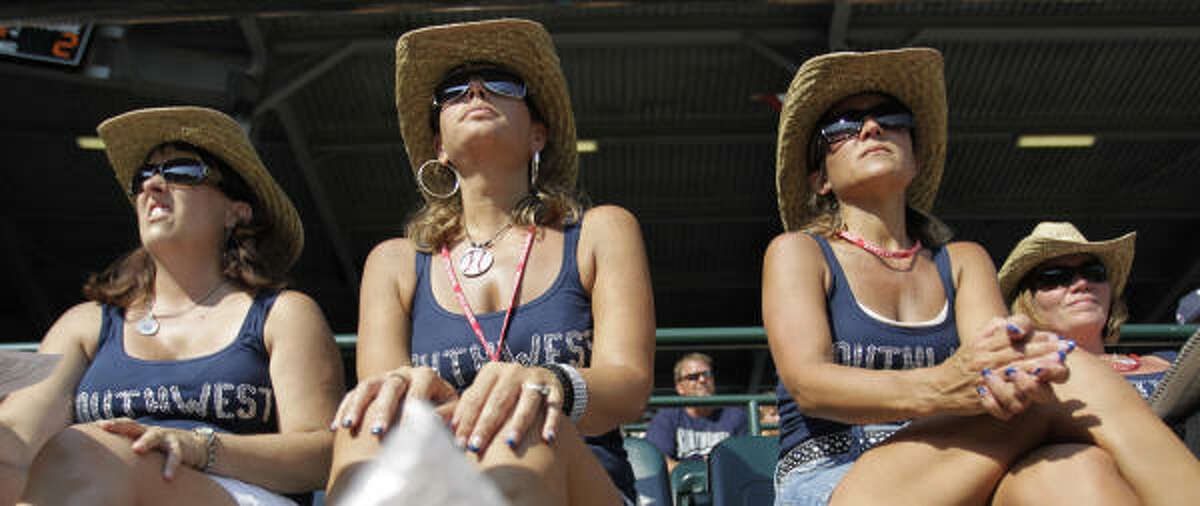 Pearland moms, in attire created and donated by Kimberly Ingram of Pearland, wow the crowd at the Little League World Series in South Williamsport, Pa., and root for their boys.