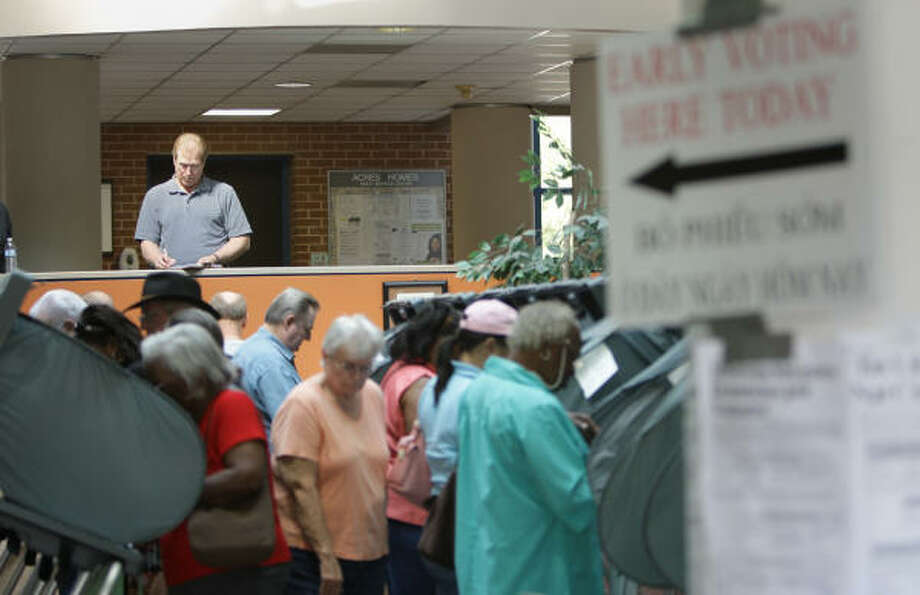 The Acres Homes Multi-Purpose Center in north Houston noted few problems Tuesday on the second day of early voting. Voters spoke of helpful elections workers and observant but not intrusive poll watchers, unlike earlier reports of voter intimidation. Photo: Karen Warren, Chronicle
