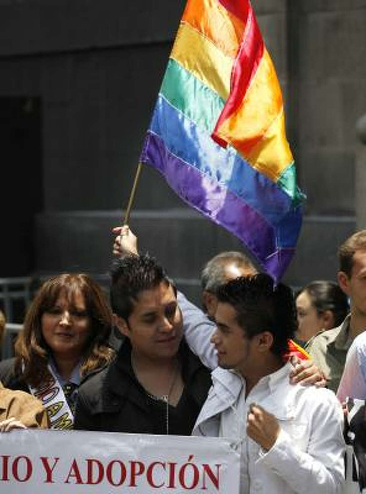 Gay couples celebrate the ruling outside the Supreme Court on Thursday. The decision quashed an appeal arguing the law violates the principle of protection of the family.