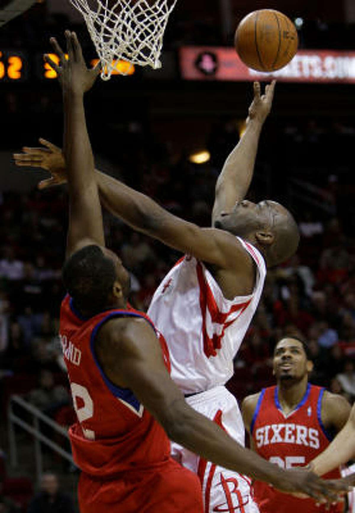 Houston Rockets (14) Carl Landry tries to get to the basket over Philadelphia 76ers (42) Elton Brand on Saturday, Feb. 6, 2010, in Houston.