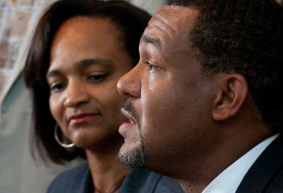 City Council member Jarvis Johnson, accompanied by his wife, Charlene, thanked her Friday for standing by him. He said a secretary was in the car with him during the disputed arrest. Photo: John Jiles, Chronicle