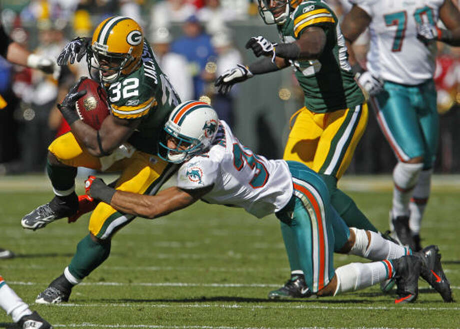 Jason Allen, making a tackle on the Packers' Brandon Jackson, had three interceptions this year for the Dolphins. Photo: Matt Ludtke, AP