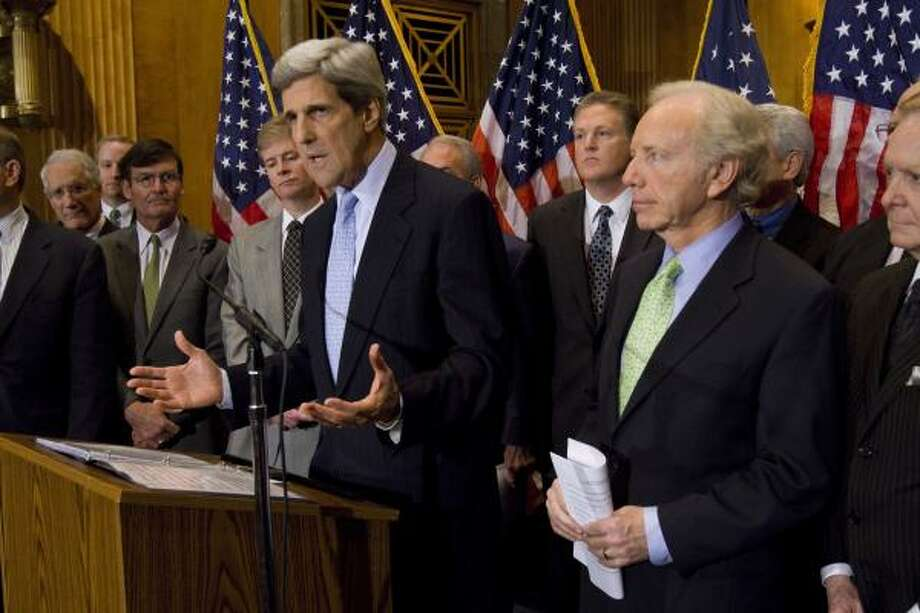 Sens. John Kerry, D-Mass., and Joseph Lieberman, I-Conn., with industry leaders, announce their climate change bill on Capitol Hill Wednesday. Photo: Harry Hamburg:, AP