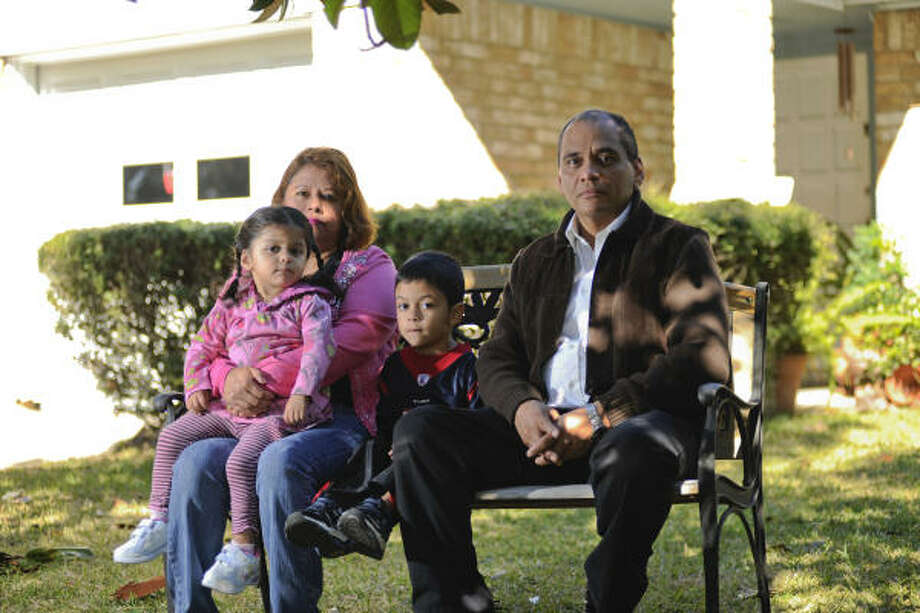 Juventino and Maria Mireles, their daughter Frances and son Christopher are about to lose their home despite hiring a firm to intervene for them. Photo: Prentice Danner, Chronicle