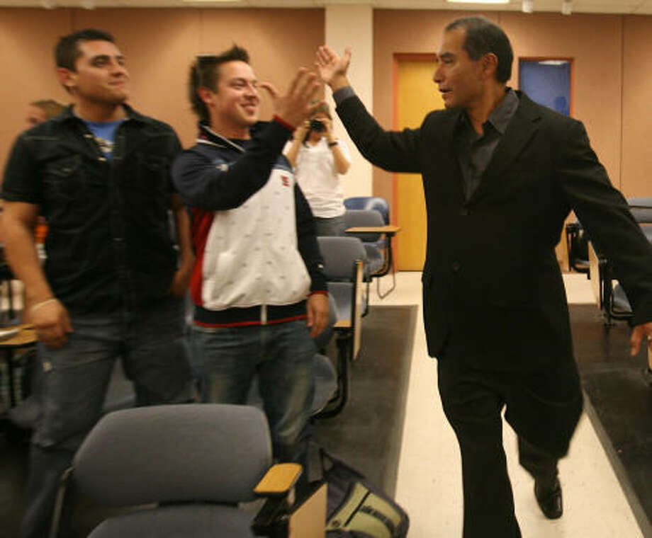 On Oct. 20, car dealership owner Raymond Palacio, right, greeted UTEP business students Manuel Acosta, left, and Eder Diaz, before a speech to students. Acosta, 25, and Diaz, 23, were shot and killed Nov. 2 in Ciudad Juarez. Photo: Victor Calzada, Associated Press