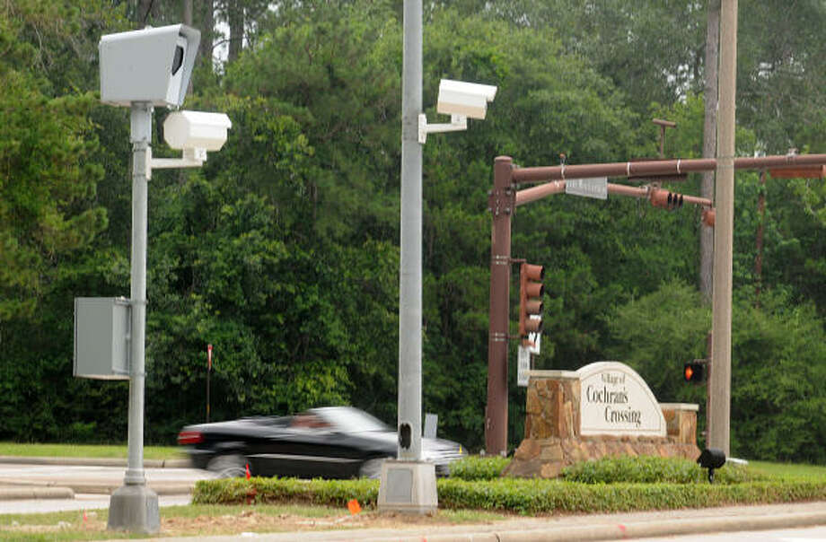 Red-light cameras will remain in The Woodlands - Houston