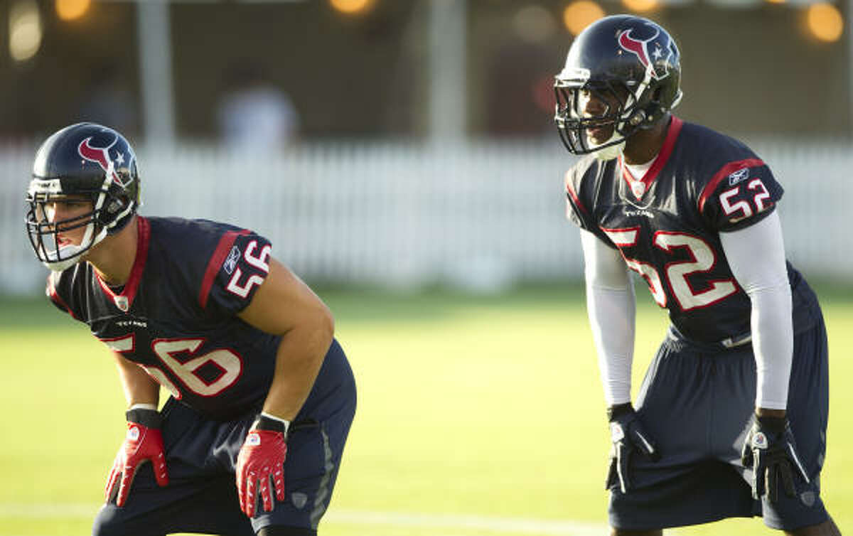 Brian Cushing (56) can practice in camp and play in preseason games with fellow Texans linebacker Xavier Adibi (52), but Cushing must sit out the first four regular-season games.