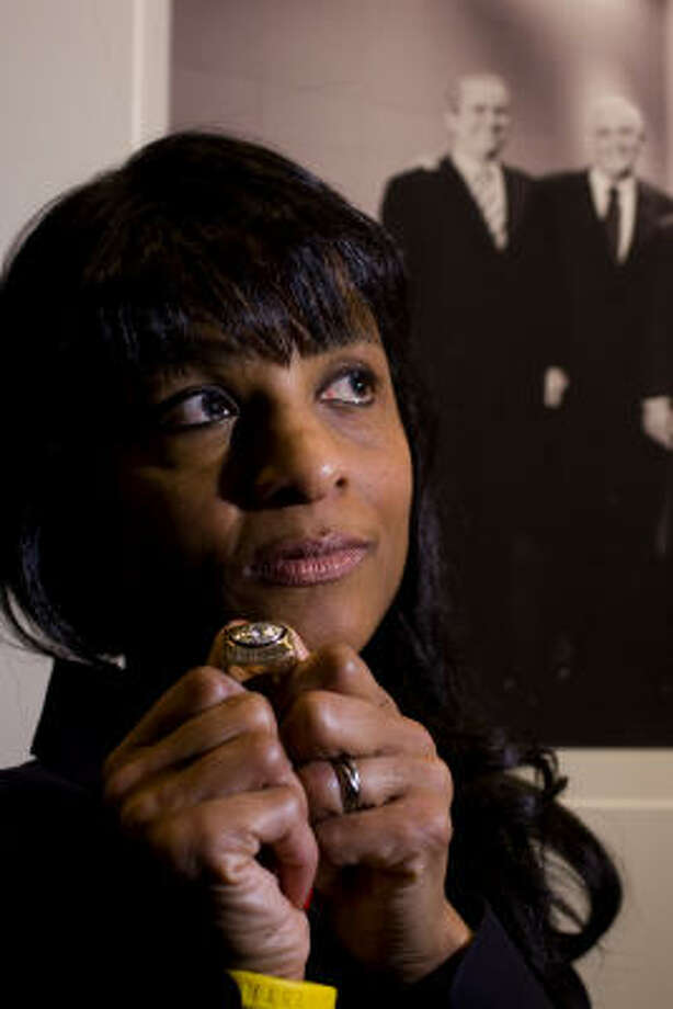 With a picture of the late attorney John O'Quinn and her friend Gerald Treece behind her, Lydia Manley, the wife of former football player Dexter Manley, was given a Super Bowl ring and asked to return it to her husband. Photo: Johnny Hanson, Chronicle