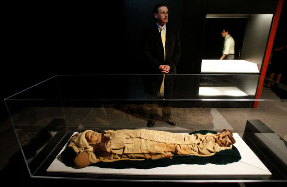 "Dirk van Tuerenhout, curator of anthropology at the Houston Museum of Natural Science, on Tuesday discusses the mummy known as the ""Beauty of Xiaohe."" The 3,800-year-old remains of the woman with Caucasian physical features were found in China. She is a highlight of the Secrets of the Silk Road exhibit opening Aug. 27. Photo: Melissa Phillip, Chronicle"