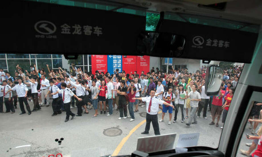 Hundreds wait to catch a glimpse of there basketball hero Yao Ming as the Rockets and Yao arrive for the team shootaround at the Guangzhou Sports University Gymnasium on Friday. Photo: Billy Smith II, Chronicle