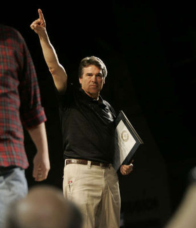 Rick Perry, shown on April 24 at a Glenn Beck tea party rally in Tyler, insists he has only one goal — returning for another term as governor of Texas. Photo: Mike Fuentes, Associated Press